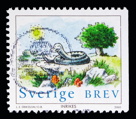 MOSCOW, RUSSIA - MAY 10, 2018: A stamp printed in Sweden shows Snake under the sun, Nelson coiled on rock serie, Chinese New Year 2001: Year of the Snake circa 2001 Editorial