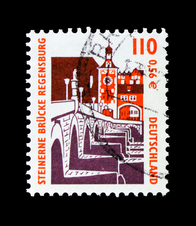 MOSCOW, RUSSIA - OCTOBER 21, 2017: A stamp printed in German Federal republic shows Stone bridge, Regensburg, Sights serie, circa 2000 Editorial