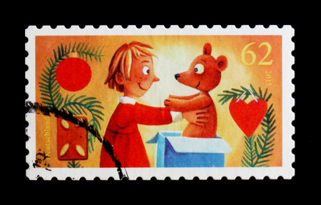 MOSCOW, RUSSIA - OCTOBER 21, 2017: A stamp printed in German Federal Republic shows Child with Teddy, Christmas 2015 serie, circa 2015