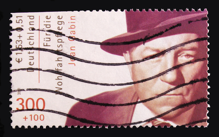 MOSCOW, RUSSIA - OCTOBER 21, 2017: A stamp printed in German Federal Republic shows Jean Gabin, Welfare: International Movie Actors serie, circa 2001 Editorial