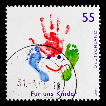 MOSCOW, RUSSIA - OCTOBER 21, 2017: A stamp printed in German Federal Republic shows Kids draw with hand and legs stamp, For us children serie, circa 2004