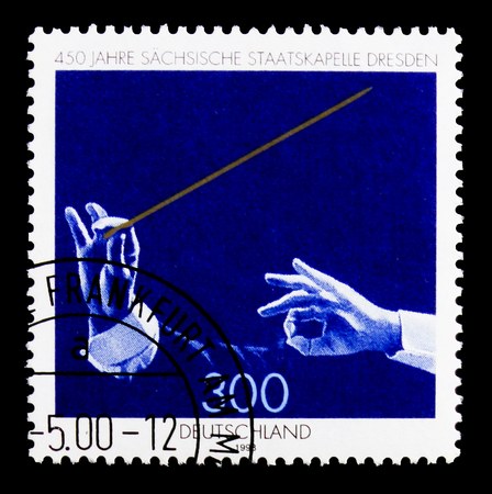 MOSCOW, RUSSIA - OCTOBER 3, 2017: A stamp printed in Germany Federal Republic shows Saxony State Orchestra, 450th Anniversary of Saxon State Orchestra, Dresden serie, circa 1998