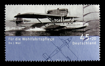 MOSCOW, RUSSIA - OCTOBER 21, 2017: A stamp printed in German Federal Republic shows Flight boat Dornier Th J whale (1923), Welfare: Airplanes serie, circa 2008 Standard-Bild - 104796080