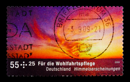 MOSCOW, RUSSIA - OCTOBER 21, 2017: A stamp printed in German Federal republic shows Sunset, Welfare: Celestial phenomena, circa 2009