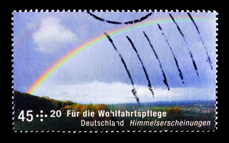 MOSCOW, RUSSIA - OCTOBER 21, 2017: A stamp printed in German Federal republic shows Rainbow, Welfare: Celestial phenomena, circa 2009 Editorial