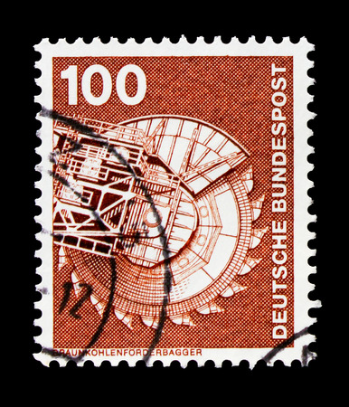 MOSCOW, RUSSIA - OCTOBER 21, 2017: A stamp printed in German Federal republic shows Brown coal conveyor excavator, Industry and Technology Definitives 1975-1982 serie, circa 1975