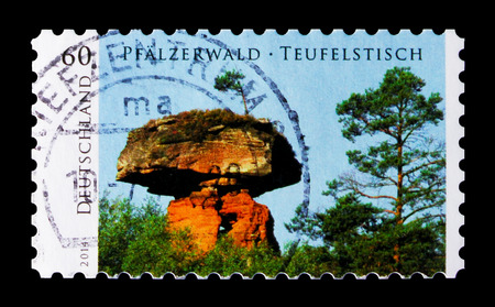 MOSCOW, RUSSIA - OCTOBER 21, 2017: A stamp printed in German Federal Republic shows Devils Table at Hinterweidenthal, Palatinate Forest, Wild Germany serie, circa 2014 Editorial