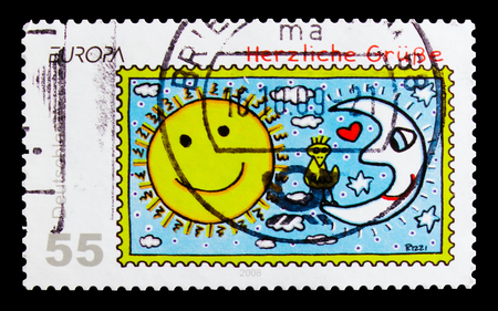 MOSCOW, RUSSIA - OCTOBER 21, 2017: A stamp printed in German Federal Republic shows Sun and Moon, Kind Regards, Greeting Stamps serie, circa 2008