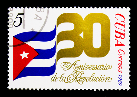 MOSCOW, RUSSIA - NOVEMBER 25, 2017: A stamp printed in Cuba shows National Flag, The 30th Anniversary of the Revolution serie, circa 1989