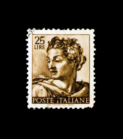 MOSCOW, RUSSIA - NOVEMBER 24, 2017: A stamp printed in Italy shows Head of the prophet Isaiah, Works of Michelangelo serie, circa 1961 Editorial