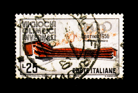 MOSCOW, RUSSIA - NOVEMBER 24, 2017: A stamp printed in Italy shows Ice Stadium and Mount Pomagagnon, VII Winter Olympic Games in Cortina serie, circa 1956 Editorial