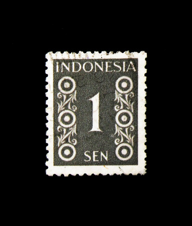 MOSCOW, RUSSIA - NOVEMBER 24, 2017: A stamp printed in Indonesia shows Numeral, serie, circa 1949 Editorial