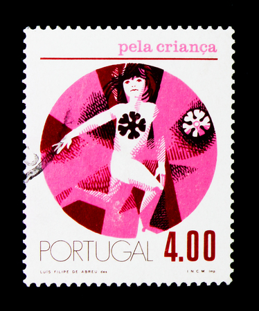 MOSCOW, RUSSIA - NOVEMBER 24, 2017: A stamp printed in Portugal shows Child running to right, For the Child serie, circa 1973