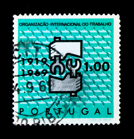 MOSCOW, RUSSIA - NOVEMBER 24, 2017: A stamp printed in Portugal shows International Labour Organisation, 50th Anniversary, serie, circa 1969