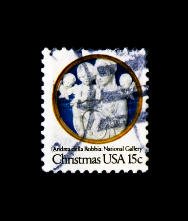 MOSCOW, RUSSIA - NOVEMBER 24, 2017: A stamp printed in USA shows Madonna and Child with Cherubim, by Andrea della Robbia, Christmas serie, circa 1978 写真素材 - 104796672