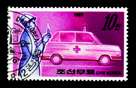 MOSCOW, RUSSIA - NOVEMBER 24, 2017: A stamp printed in Democratic Peoples republic of Korea shows Nurse and ambulance, Public services serie, circa 1989