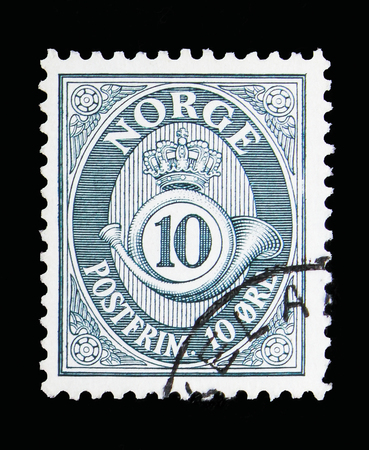 MOSCOW, RUSSIA - MAY 13, 2018: A stamp printed in Norway shows Post horn, 10 Ore due, serie, circa 1950