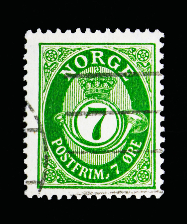 MOSCOW, RUSSIA - MAY 13, 2018: A stamp printed in Norway shows Posthorn - New Die, 7 Ore due, serie, circa 1941