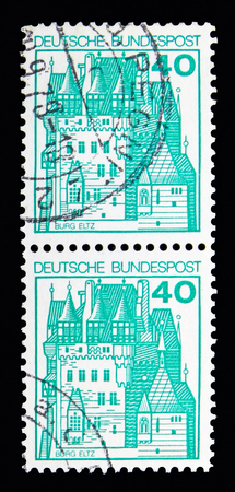 MOSCOW, RUSSIA - MAY 13, 2018: Two postage stamps printed in Federal Republic of Germany shows Eltz Castle, Strongholds and Castles serie, circa 1977