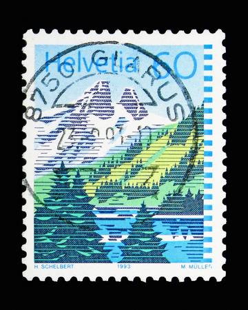MOSCOW, RUSSIA - MAY 13, 2018: A stamp printed in Switzerland shows Lake Tanay, Mountain lakes serie, circa 1983