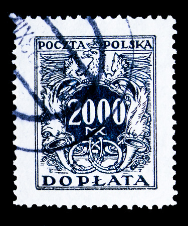 MOSCOW, RUSSIA - MAY 13, 2018: A stamp printed in Poland shows Eagle on a shield, serie, circa 1923