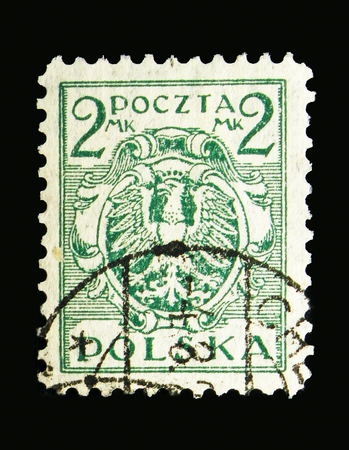 MOSCOW, RUSSIA - MAY 13, 2018: A stamp printed in Poland shows Eagle on a baroque shield, serie, circa 1921
