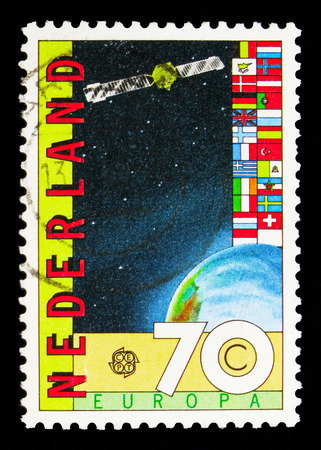 MOSCOW, RUSSIA - MAY 13, 2018: A stamp printed in Netherlands shows ECS communication satellite, flags of ECS countries, Great achievement of Human spirit serie, circa Editorial
