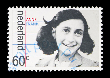 MOSCOW, RUSSIA - MAY 13, 2018: A stamp printed in Netherlands shows Family portrait of Anne Frank, Occupation and liberation serie, circa 1980 에디토리얼