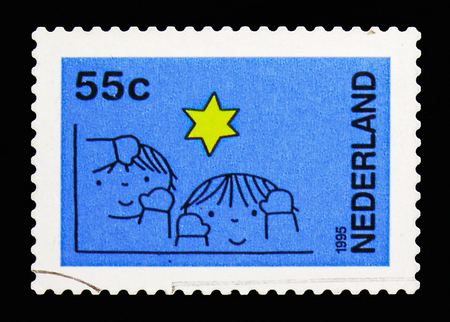 MOSCOW, RUSSIA - MAY 13, 2018: A stamp printed in Netherlands shows Children and stars, December stamps serie, circa 1995