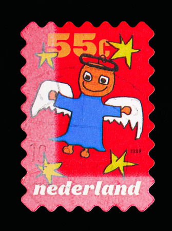 MOSCOW, RUSSIA - MAY 13, 2018: A stamp printed in Netherlands shows Angel, December stamps serie, circa 1999 Stok Fotoğraf