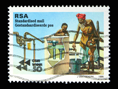 MOSCOW, RUSSIA - MAY 13, 2018: A stamp printed in South Africa shows Purifying water, 50th Anniversary of CSIR serie, circa 1995