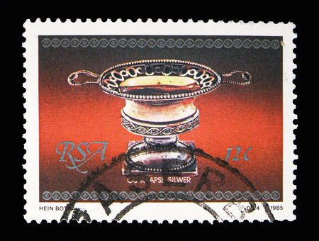 MOSCOW, RUSSIA - MAY 13, 2018: A stamp printed in South Africa shows Sugar, Piece of silverware serie, circa 1985