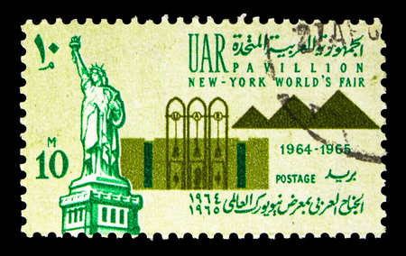 MOSCOW, RUSSIA - MAY 13, 2018: A stamp printed in Egypt shows Statue of Liberty and World's Fair Pavilion - Pyramids, New York World's Fair 1964-65 serie, circa 1964 Editorial
