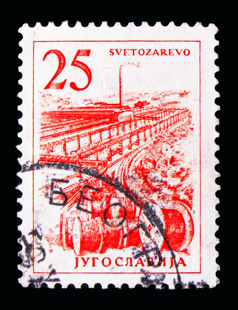 MOSCOW, RUSSIA - MAY 13, 2018: A stamp printed in Yugoslavia shows Cable factory in Svetozarevo, Engineering and Architecture serie, circa 1961