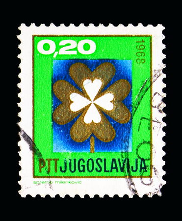 MOSCOW, RUSSIA - MAY 13, 2018: A stamp printed in Yugoslavia shows Lucky Clover, New Year 1968 serie, circa 1967