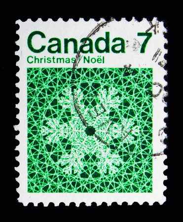 MOSCOW, RUSSIA - MAY 13, 2018: A stamp printed in Canada shows Snowflake, Christmas serie, circa 1971