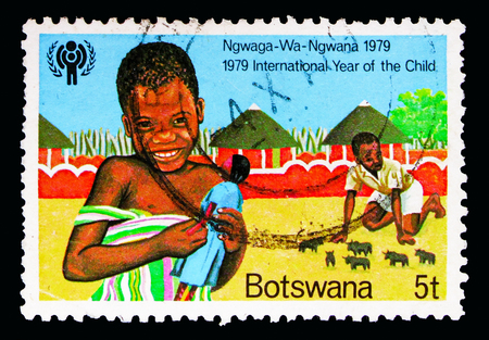 MOSCOW, RUSSIA - MAY 16, 2018: A stamp printed in Botswana shows Children playing, International Year of the Child serie, circa 1979 Editorial
