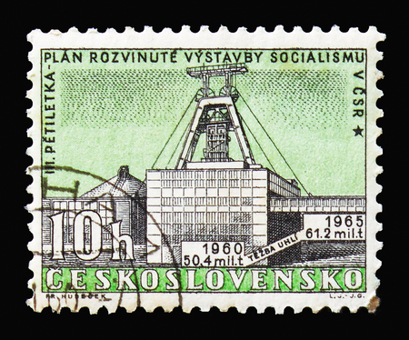MOSCOW, RUSSIA - AUGUST 18, 2018: A stamp printed in Czechoslovakia shows Stalin Mine, 3rd Five-Year Plan serie, circa 1960