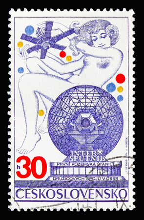 MOSCOW, RUSSIA - AUGUST 18, 2018: A stamp printed in Czechoslovakia shows Intersputnik, serie, circa 1974