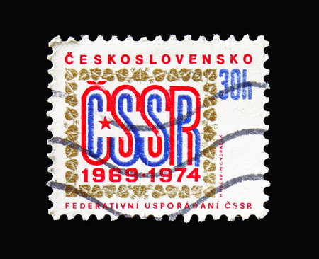 MOSCOW, RUSSIA - AUGUST 18, 2018: A stamp printed in Czechoslovakia shows 5th anniversary of Federal Government, serie, circa 1974
