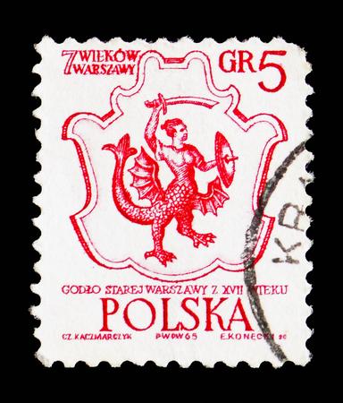 Moscou, Russie - 15 septembre 2018 : un timbre imprimé en Pologne montre les armoiries de Varsovie, 17e siècle, 700e anniversaire de la série Varsovie, vers 1965