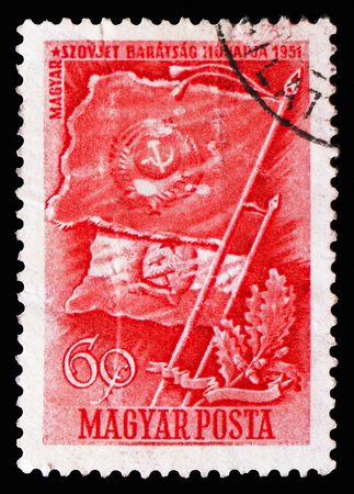 MOSCOW, RUSSIA - SEPTEMBER 15, 2018: A stamp printed in Hungary shows Flags of the Soviet Union and Hungary, Hungarian-Russian Friendship serie, circa 1951