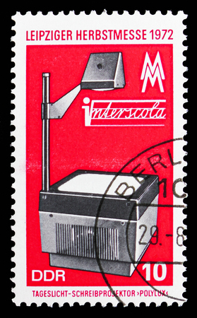 MOSCOW, RUSSIA - SEPTEMBER 15, 2018: A stamp printed in DDR (Germany) shows Overhead projector, Leipzig Autumn Fair serie, circa 1972 Editorial