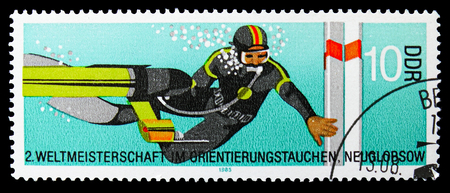 MOSCOW, RUSSIA - SEPTEMBER 15, 2018: A stamp printed in DDR (Germany) shows Diver at buoy, Championships In Orienteering Diving, Neuglobsow serie, circa 1985