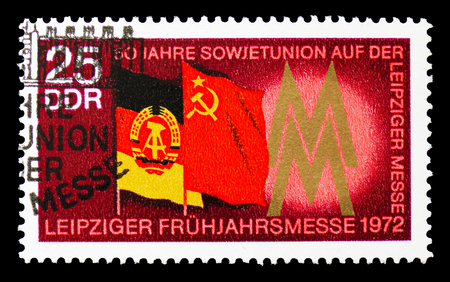 MOSCOW, RUSSIA - SEPTEMBER 15, 2018: A stamp printed in DDR (Germany) shows Flags of the GDR and USSR, Leipzig Spring Fair serie, circa 1972 Redakční