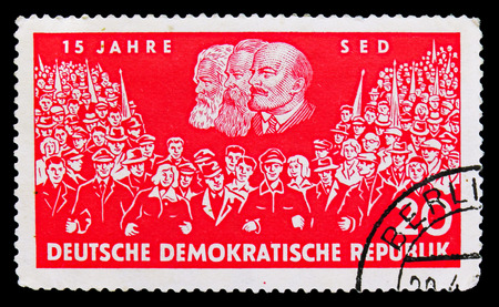 MOSCOW, RUSSIA - SEPTEMBER 15, 2018: A stamp printed in DDR (Germany) shows Union of two demonstrations, portraits of Marx, Engels and Lenin, 15 years Socialist Unity Party of Germany (SED) serie, circa 1961 Editorial