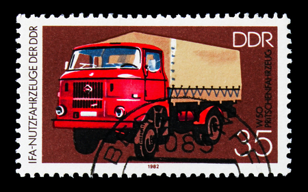 MOSCOW, RUSSIA - AUGUST 18, 2018: A stamp printed in Germany Democratic Republic shows Flatbed Truck W 50, IFA: Commercial Vehicles serie, circa 1982