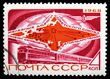MOSCOW, RUSSIA - OCTOBER 21, 2018: A stamp printed in USSR (Russia) shows Electric Train and Map, Soviet Railways serie, circa 1968