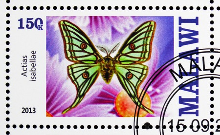 MOSCOW, RUSSIA - OCTOBER 21, 2018: A stamp printed in Malawi shows Actias isabellae, serie, circa 2013