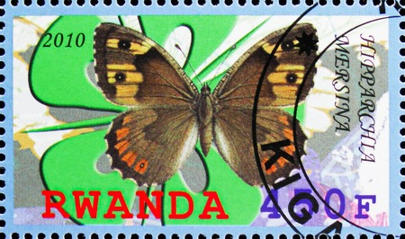 MOSCOW, RUSSIA - OCTOBER 21, 2018: A stamp printed in Rwanda shows Hipparchia Mersina, Butterflies serie, circa 2010 Редакционное
